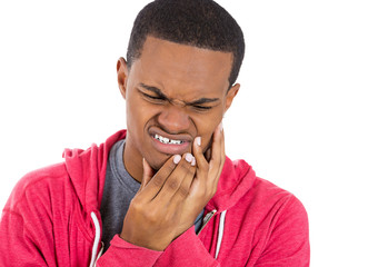 Young man having toothache