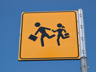 Children crossing street sign