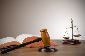 Golden scales of justice, gavel and books