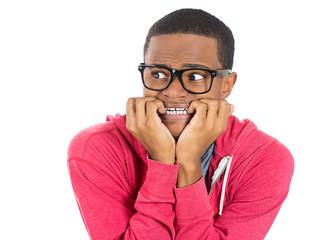 Stressed, shy, anxious, nerdy man biting his fingernails