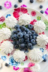 Blueberries with meringues