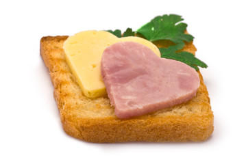 Toast with heart-shaped Ham and Cheese isolated on white