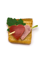Toast with heart-shaped Paprika and Ham isolated on white