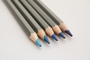 Blue Colouring Pencils on a white background
