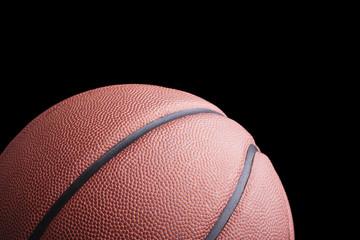 Basketball ball against dark background