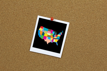 USA map on instant photo pinned to a cork board