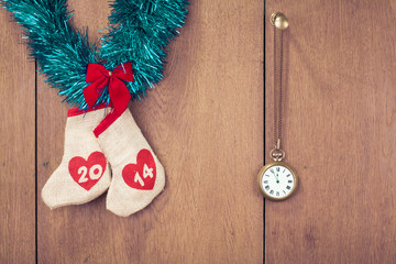 New Year date wishes bags, watches on wood wall background