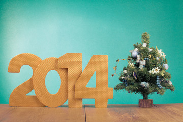 Greeting card with date and New Year tree