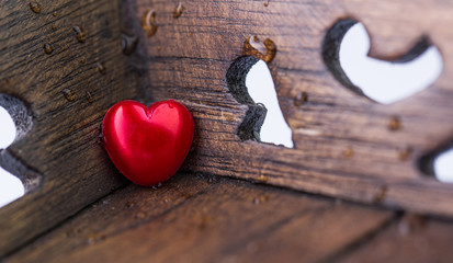 Red Valentine heart object and wood surface