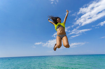Happy teen jumping isolated on clear water horizon