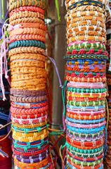 Many various leather and textile bracelets