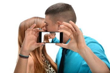 Couple Taking Photo while Kissing