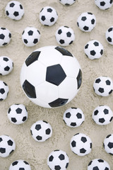 Many Footballs Soccer Balls Different Sizes Beach Sand