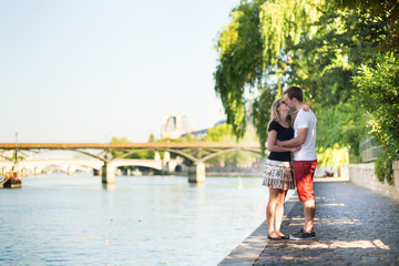 Couple in love near the Seine