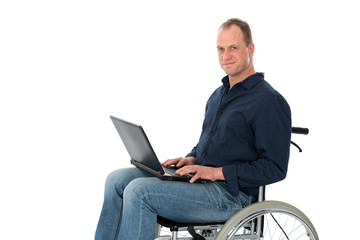 young man in wheelchair working with the computer