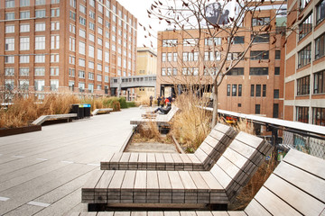 People relaxing and strolling on The High Line.