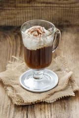 Irish coffee on wooden table