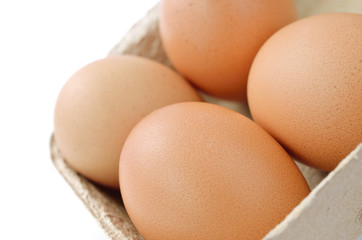 Fresh eggs with a carton box