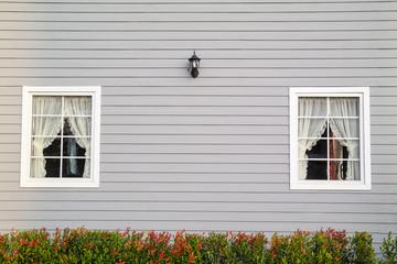 Windows in wooden wall