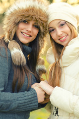 Two beautiful girls outdoor in winter