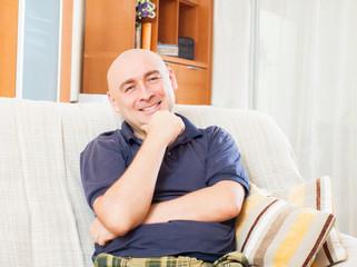 adult man sitting on sofa