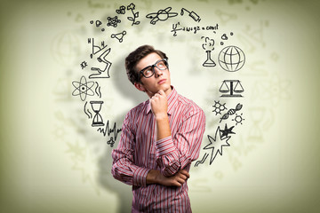 young man scientist with glasses thinking