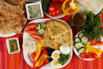 Traditional Turkish breakfast on fabric background