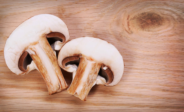 Sliced Mushrooms over wooden background. Baby Bella