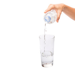 Female hands pouring water into a glass