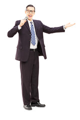 Full length portrait of a male announcer holding microphone