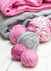 balls of pink and gray yarn
