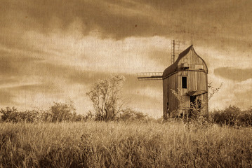 Old wooden windmill. vintage image of old buildings