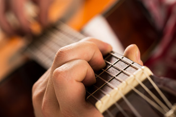 Music, close-up. Young musician holding electro guitar