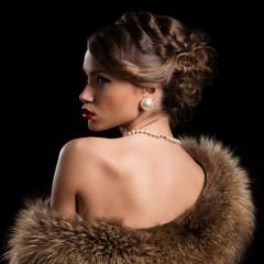 Vintage, retro. Beautiful, attractive woman wearing fur