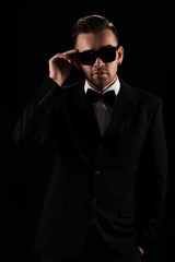 Handsome man in black suit and sunglasses