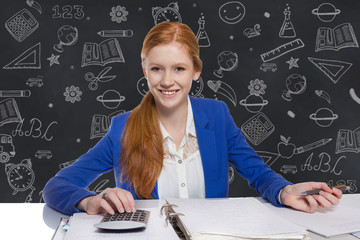 Young businesswoman is  calculating and writing on a paper