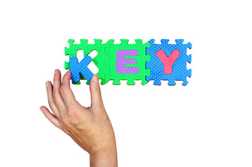 Women hold K alphabet put to its hole for successfully key word