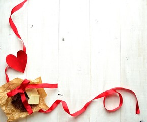 Chocolate,heart and red ribbon.Image of Valentines day