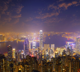 Hong Kong city skyline panorama at night with Victoria Harbor an