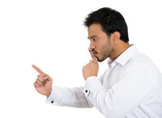 Serious annoyed man asking for silence