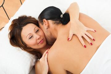 adult couple having sex on white sheet