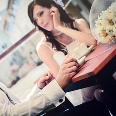 unusual loving wedding couple in cafe drinks cappuccino