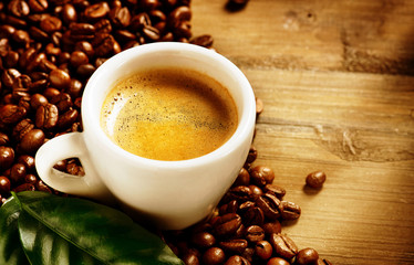 Coffee Espresso. Cup Of Coffee with Beans and Green Leaf