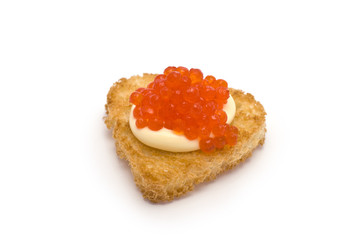 Heart-Shaped Toast with Red Caviar on White Sauce isolated on wh