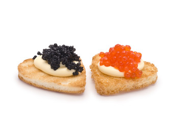 Two Heart-Shaped Toasts with Red and Black Caviar on White Sauce