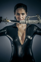 Sexy girl military woman posing with guns.