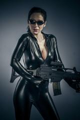 Erotic, Sexy girl military woman posing with guns.