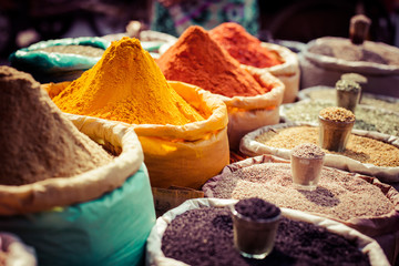 Stores photo Delhi Indian colored spices at local market.