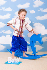 boy playing with a wooden horse