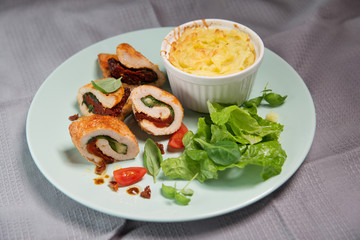 Chicken fillet stuffed with basil, mozzarella and dried tomatoes